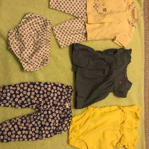 7 different baby outfits, tops and bottoms. 3mos.